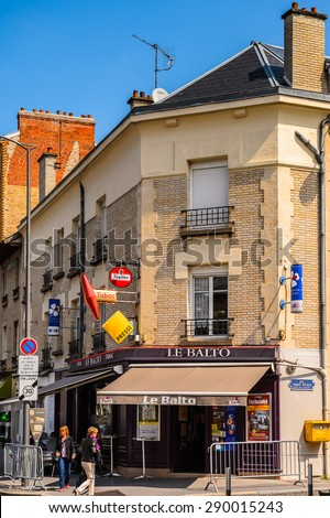 REIMS, FRANCE - JUN 9, 2015: Buildings in  Reims, a city in the Champagne-Ardenne region of France.