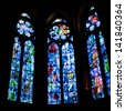 REIMS, FRANCE - JUNE 29: stained glass windows in Cathedral in Reims, France on June 29, 2010. Chapel stained glass windows were designed by Marc Chagall in 1974. - stock photo