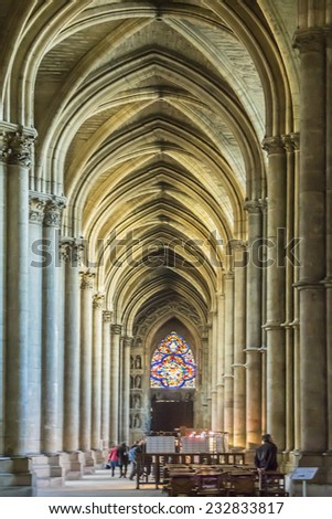 REIMS, FRANCE - NOVEMBER 11, 2014: Interior of Notre-Dame de Reims cathedral (Our Lady of Reims, 1275). Cathedral is the seat of the Archdiocese of Reims, where the kings of France were crowned.