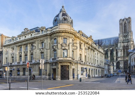REIMS, FRANCE - NOVEMBER 11, 2014: The streets of the historic center of Reims - city in Champagne-Ardenne region of France, lies 129 km east-northeast of Paris. - stock photo