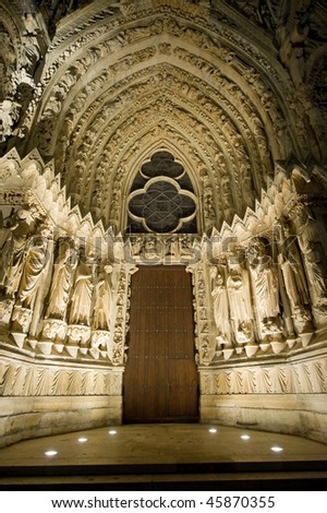 Reims (Marne, Champagne-Ardenne, France) - Exterior of the cathedral in gothic style. Facade portal by night. - stock photo