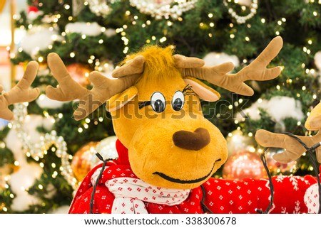 Reindeer Standing By a Christmas Tree - stock photo