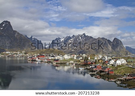 Reine - idyllic fishing village in front of the magnificent peaks of the Lofoten wall