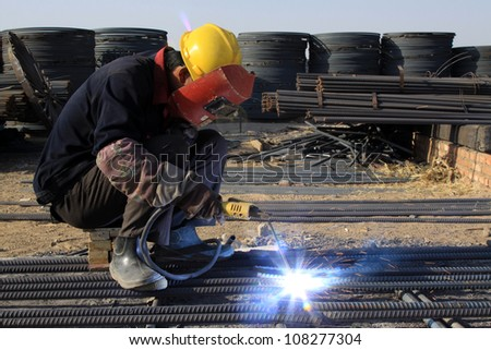 reinforced component at the construction site and workers, north china - stock photo