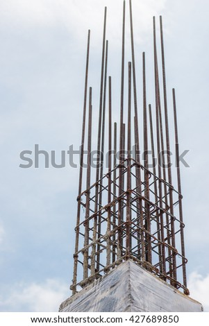 reinforced concrete columns on blue sky background - stock photo