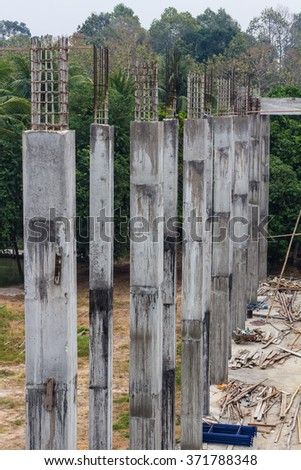 Reinforced concrete pillar, which is building a base of a large building in the countryside. - stock photo