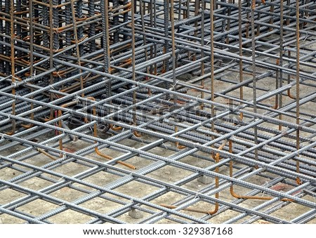 Reinforced steel bars are being prepared for a concrete foundation  - stock photo