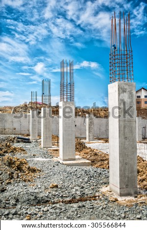 Reinforced steel bars on construction pillars, concrete details and beams at building site.  - stock photo