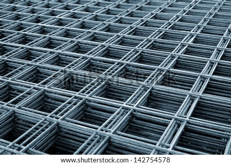 Reinforcing steel mesh, close up image of construction material. - stock photo