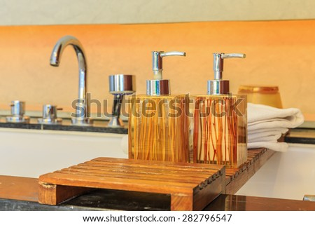 reisin soap bottles on the wooden in the bathroom
