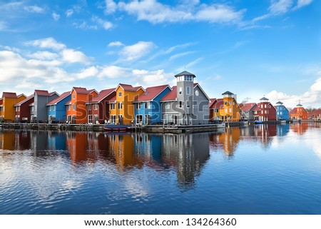 Reitdiephaven - colorful buildings on water in Groningen, Netherlands - stock photo