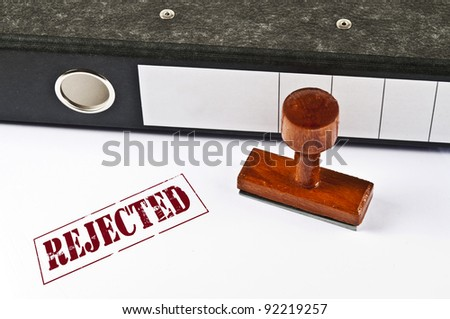 Rejected stamp on white paper - stock photo