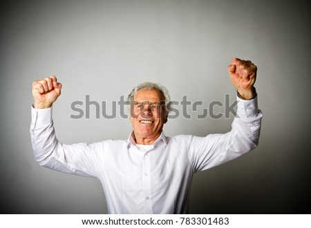 Rejoicing old man. Success concept.