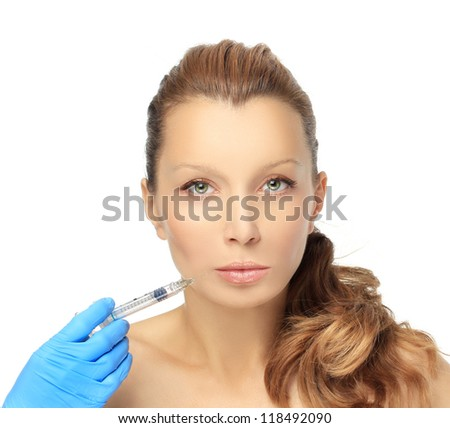 Rejuvenation.Closeup of a young woman getting an injection  of beauty products - stock photo