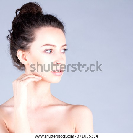 Rejuvenation program. Beautiful woman with long neck touching cheek. Lifting skin. - stock photo