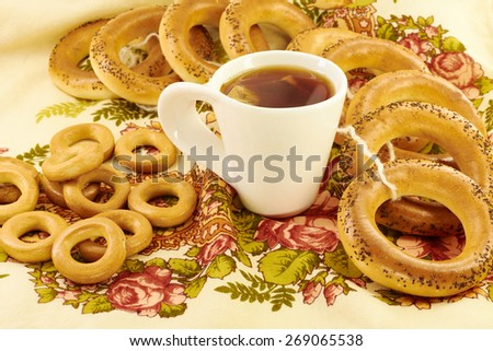 Related bagels with poppy seeds and black tea - stock photo