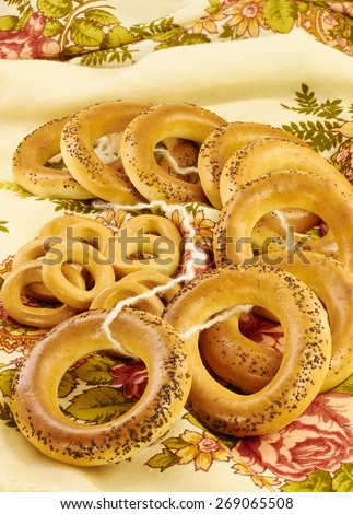 Related bagels with poppy seeds on a napkin - stock photo