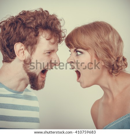 relationship difficulties. Angry woman and man yelling at each other. Face to face.