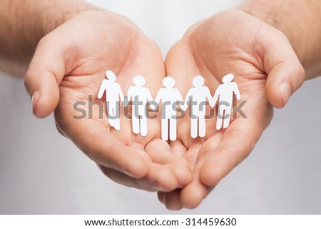 relationships and love concept - man hands showing paper cutout team - stock photo