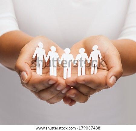 relationships and love concept - womans hands showing paper cutout team - stock photo