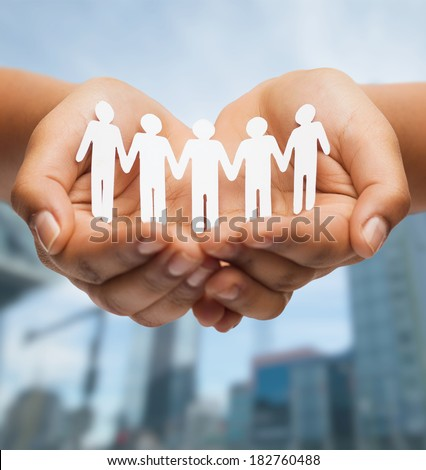 relationships and love concept - womans hands showing paper cutout team