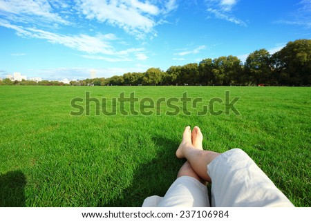 Relax barefoot enjoy nature in the green lawn - stock photo