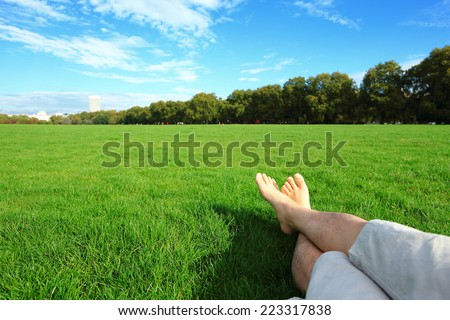Relax barefoot enjoy nature in the green lawn,  Hyde Park in London, United Kingdom, UK - stock photo