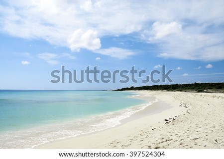 Relax beach with white sand, blue sky and clear water in Cancun, Mexico - stock photo