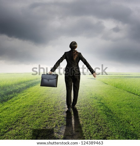 Relax business woman holding bag on Way of Grass Grass fields and rainclouds