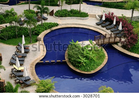 Relax by the pool on your all inclusive tropical island resort holiday - stock photo