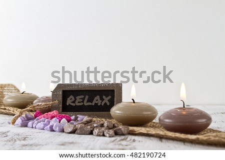 Relax concept with burning candles and stones
