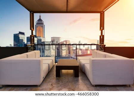 Relax coner on condominium roof top with sofa and table.
