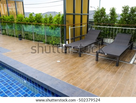 Relax corner on condominium rooftop with chairs