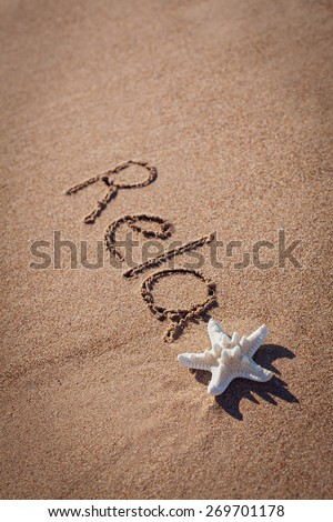 relax drawing on beach. Summer concept with starfish on sands. - stock photo