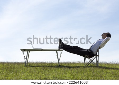 Relax -/ Hands Behind Head - stock photo