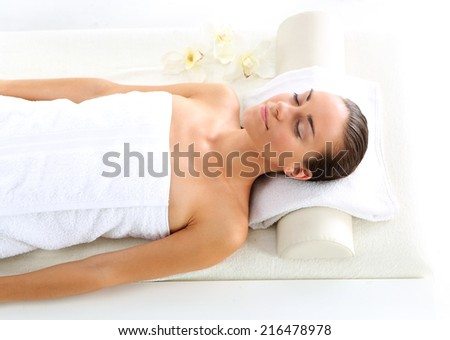 Relax in the spa - woman at face massage .Attractive brunette woman in spa salon.