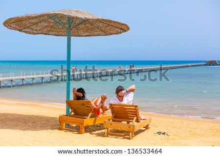 Relax of loving couple on the beach at Red Sea in Egypt - stock photo