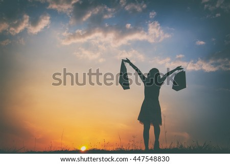 Relax Woman holding shopping bags in sunset silhouette.Summer Vacation concept.Vintage Tone.