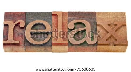 relax word in vintage wood letterpress printing blocks, isolated on white