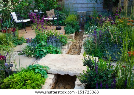 Relaxation area in a garden - stock photo