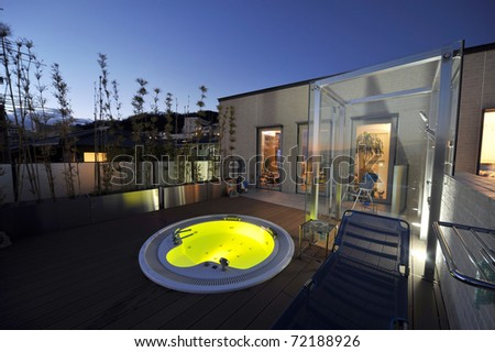 relaxation in luxury bubble bath at night on yellow - stock photo