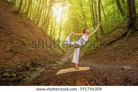 Relaxation joga pose  in wonderful  forest . - stock photo