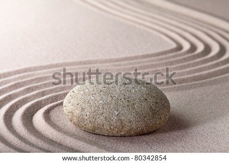 relaxation zen garden japanese garden zen stone with raked sand and round stone tranquility and balance ripples sand pattern meditation - stock photo