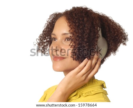 Relaxed and composed young woman listening to music