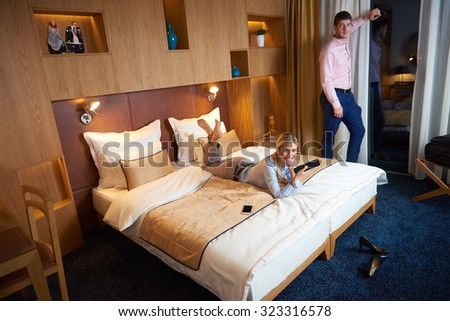 relaxed and happy young couple in modern hotel room