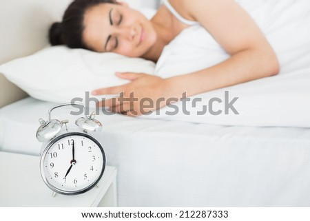 Relaxed beautiful young woman sleeping in bed at home