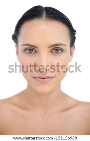 Relaxed brunette in close up on white background - stock photo