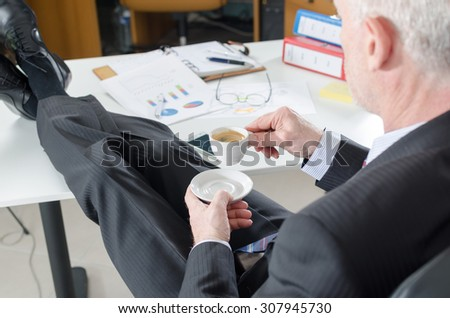 Relaxed businessman during a break drinking coffee