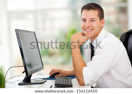 relaxed businessman sitting in modern office - stock photo