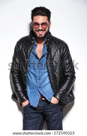 relaxed casual man in leather jacket smiling to the camera